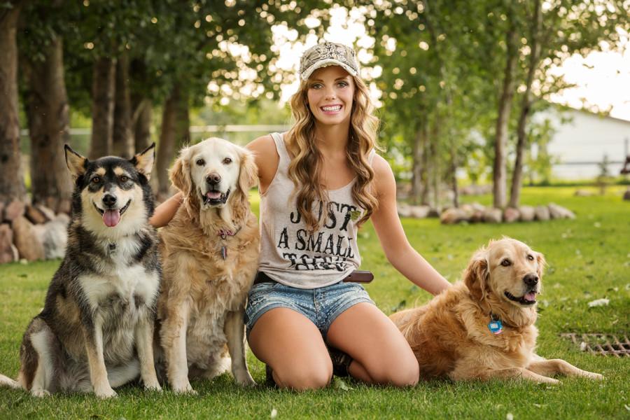 Girl cuddling dogs at Henderson Lake